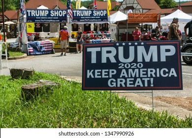 Helen, GA / USA - June 2, 2018:  A Donald Trump 2020 presidential election campaign sign sits in the grass in front of the Trump Shop, a popup outdoor store selling Trump apparel.