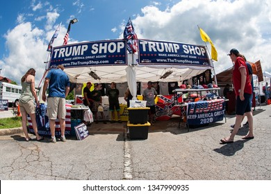Helen, GA / USA - June 2, 2018:  Couples shop for merchandise at the Trump Shop, a popup outdoor store selling Donald Trump apparel and other items in a parking lot on June 2, 2018 in Helen, GA.