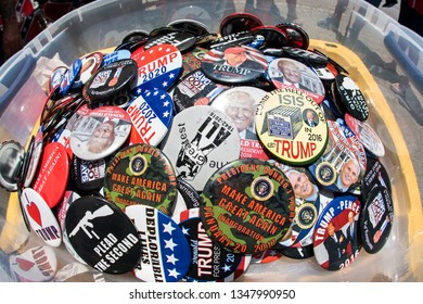 Helen, GA / USA - June 2, 2018:  An assortment of Donald Trump campaign and conservative political buttons sits on display at the Trump Shop, a popup outdoor store selling Trump apparel in Helen, GA.