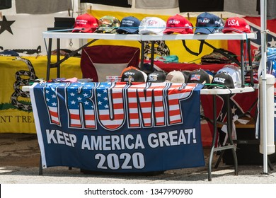 Helen, GA / USA - June 2 2018:  An assortment of Donald Trump and conservative merchandise sits on display at the Trump Shop, a popup outdoor store selling Donald Trump apparel in Helen, GA.