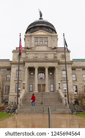 Helena, Montana / USA - April 14 2018:  Person ascending the front steps to the Montana State Capitol Building
