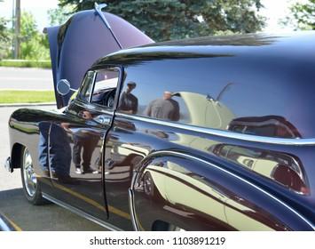 Helena, Montana,/ USA, May 28, 2018: Shiny black vintage sedan as seen from the side.