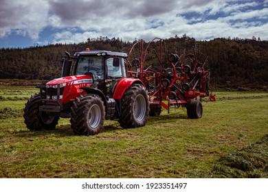 Helensville, New Zealand - 22 September 2020. 7615 Massey Ferguson towing a 1515 CD Lely rake