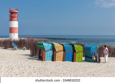 Helgoland, Germany - May 20, 2017: Seaside visitors in colorful beach chairs at Dune, German island near Helgoland