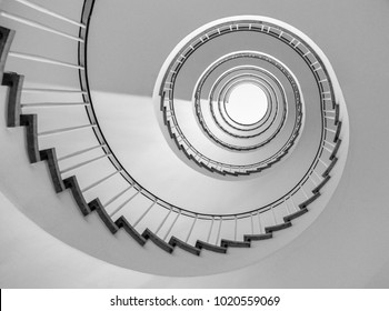 helical stairway, simple modern circular staircase, view from underneath in black and white