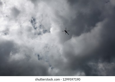 Helicopter against cloudy sky