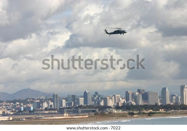 helicopter ascending away from city