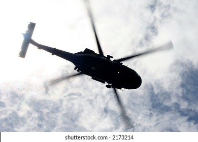 Helicopter from below with blades captured in motion