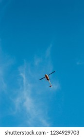 Helicopter in the ble sky