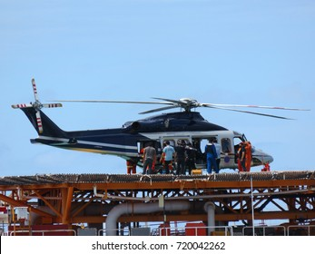 Helicopter or chopper land at oil and gas platform area for get and sent passenger from onshore hangar to offshore platform. Crew change working rotation by helicopter.