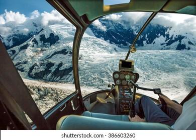 Helicopter cockpit flying. Spectacular glaciers of Denali National Park, Alaska, United States.