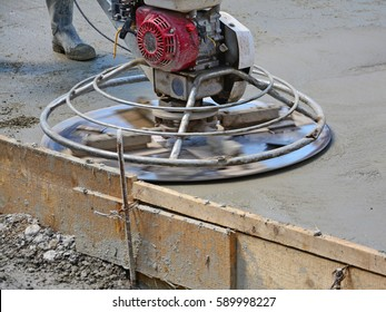 Helicopter concrete finishing. Construction worker finishing concrete with power trowel machine.