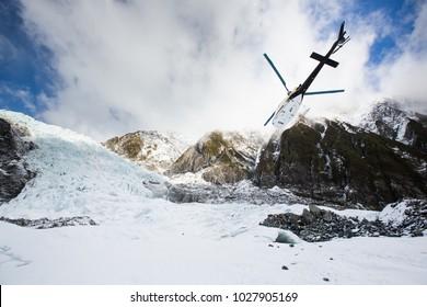 A helicopter departs Franz Josef Glacier, New Zealand.