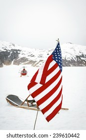 Helicopter drops off tourists at a dog sled camp at Alaska's Norris Glacier