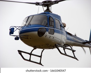 Helicopter flies on cloudy sky
