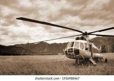 The helicopter flies over the Altai Mountains covered with forest