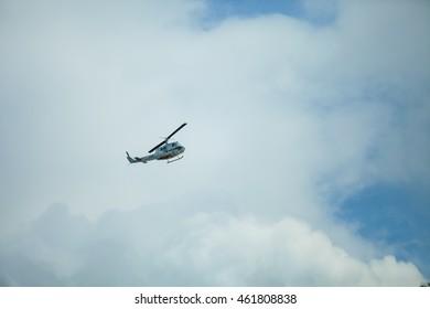 Helicopter in flight, blue sky.