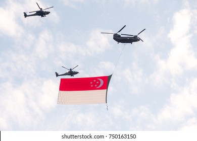 Helicopter fly on sky with flag for Fiftieth anniversary of Singapore 50 years National Day Golden Jubilee