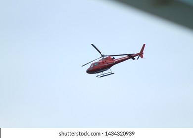 Helicopter flying across the east river as seen from the Brooklyn Bridge park located in Brooklyn NY on a sunny summer day in beooklyn NY June 24 2019
