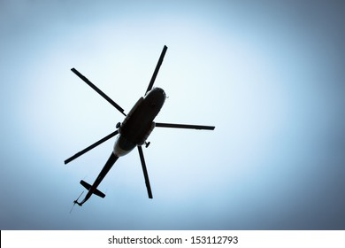 Helicopter flying against the blue sky