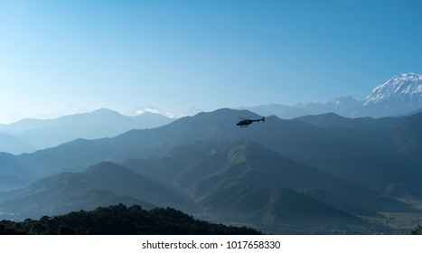 Helicopter flying among mountains, Pokhara, Nepal.