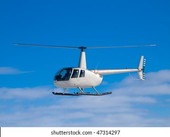 Helicopter flying in the blue sky