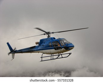 Helicopter flying in clouds