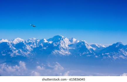 Helicopter flying on blue sky nepal  background Mountain Nepal Beautiful high angle view of nepal the Himalayas Helicopter Mount Everest northern Nepal
