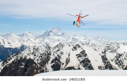 Helicopter flying over the amazing Southern Alps of New Zealand