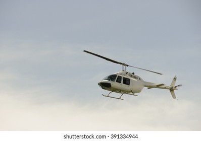 Helicopter flying over the clouds