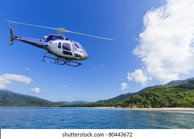 Helicopter flying over deserted Island in Angra dos Reis, Rio de Janeiro
