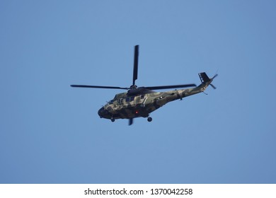 a helicopter flying in the sky