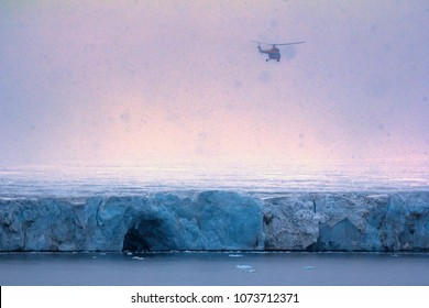 Helicopter with glaciologists and tourists-extreme over clouded Arctic glaciers. Franz-Joseph Land. Scientific expedition to outlet glacier