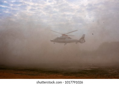 Helicopter landing in dust.