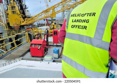 Helicopter landing officer, HLO working offshore on helidecks