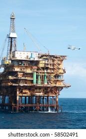 Helicopter landing in offshore oil rig.  Coast of Brazil