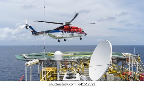 Helicopter landing on oil platform