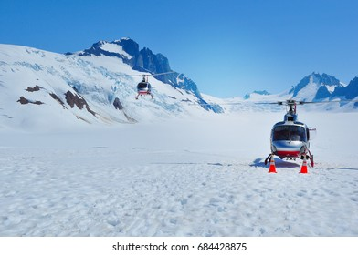 Helicopter landing on top of a glacier in Alaskan icefield
