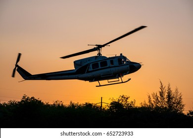 helicopter landing in sunset