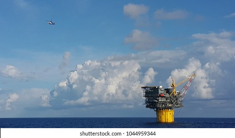 A helicopter leaving a Floating Production and Storage Spar during crew change day in an oilfield situated in Gulf of Mexico.