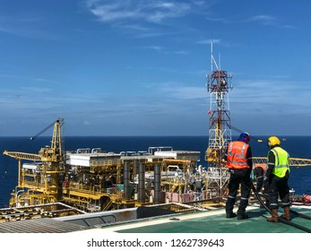 Helicopter officer working on offshore helipad or The helicopter landing officer (HLO) is on the oil rig platform in the gulf of thailand. This happened in the middle of the gulf of Thailand.
