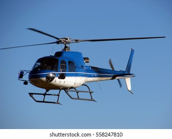 Helicopter on blue sky