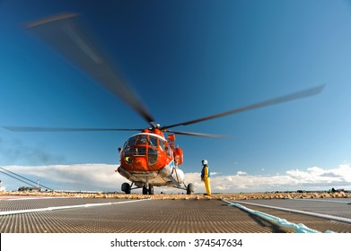Helicopter on the upper deck of the sea oil production platform, Sakhalin, Russia