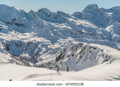 Helicopter over mountain peaks snd glacier. Transporting heliskiing clients to the mountains. Heli-skiing in Monte Rosa. Italy. Extreme winter sport. Heliski in high mountains. Freeride ski.