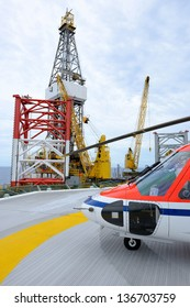The helicopter park on oil rig to pick up worker