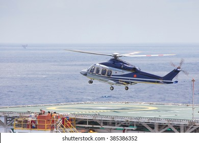 Helicopter parking at an offshore oil and gas platform to receive passenger and cargo to onshore.