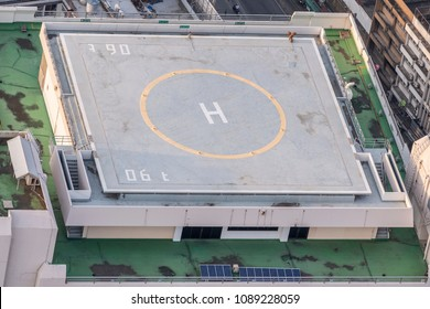 Helicopter parking on the roof of an old building. Top view