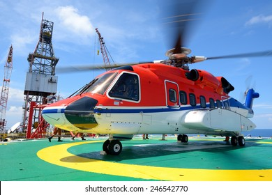 helicopter pick up passenger on the offshore oil rig platform in gulf of thailand