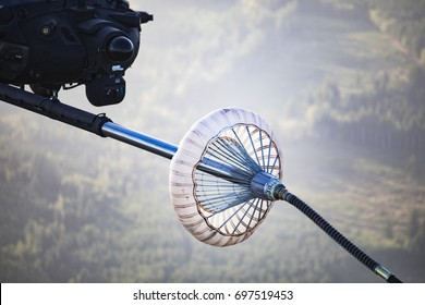 Helicopter Receives Fuel Through Refueling Basket.