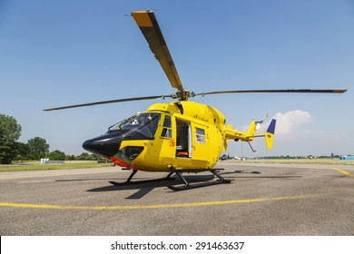 Helicopter rescue, Yellow helicopter on the ground, all logos and text removed.